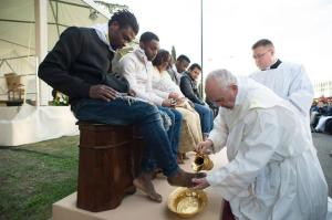 "In this handout picture released by the Vatican Press Office, Pope Francis performs the foot-washing ritual at the Castelnuovo di Porto refugees center near Rome on March 24, 2016. Pope Francis washed the feet of 11 young asylum seekers and a worker at their reception centre to highlight the need for the international community to provide shelter to refugees. Several of the asylum seekers, one holding a baby in her arms, were reduced to tears as the 79-year-old pontiff kneeled before them, pouring water over their feet, drying them with a towel and bending to kiss them. / AFP PHOTO / STR / RESTRICTED TO EDITORIAL USE - MANDATORY CREDIT ""AFP PHOTO / OSSERVATORE ROMANO"" - NO MARKETING NO ADVERTISING CAMPAIGNS - DISTRIBUTED AS A SERVICE TO CLIENTS STR/AFP/Getty Images"