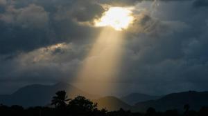 light-shining-through-dark-clouds